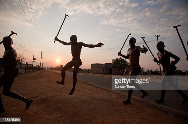 Ndebele initiates running and jumping the fire as part of the ritual during their home coming celebrations on July 10 2013 at Wolwenkop in Mpumalanga...