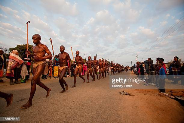 Ndebele initiates running and jumping the fire as part of the ritual during their home coming celebrations on July 10, 2013 at Wolwenkop in...