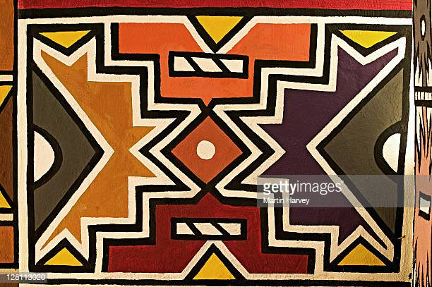 Ndebele village with traditional brightly painted geometric designs. Lesedi Cultural Village near Johannesburg, South Africa