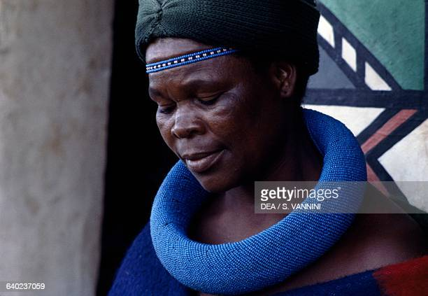 Ndebele woman wearing a headdress and traditional costume South Africa