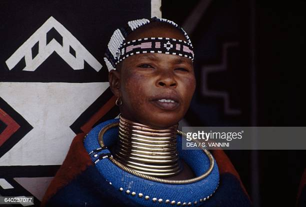 Ndebele woman wearing a traditional costume and idzilla bronze or copper neck rings South Africa