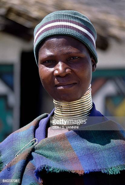 Ndebele woman wearing idzilla bronze or copper neck rings South Africa