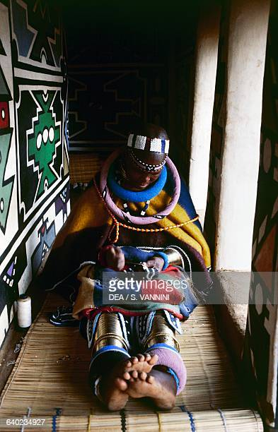 Ndebele woman wearing traditional clothes making bead decorations Ndebele village Botshabelo township Transvaal South Africa