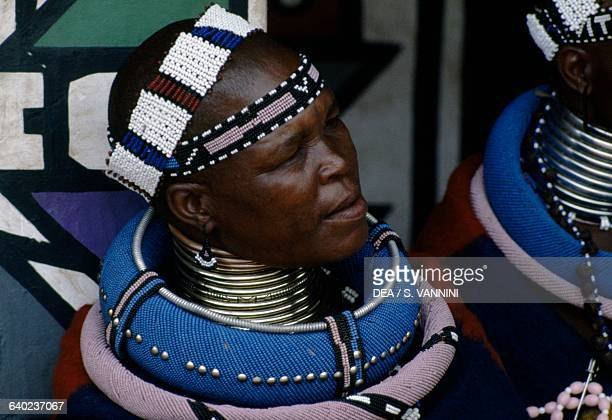 Ndebele women wearing traditional beaded headdress and idzilla bronze or copper neck rings South Africa