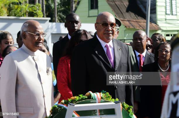 ndia President Ram Nath Kovind and Suriname President Desi Bouterse participate in a garland ceremony at the Baba Mai monument which represents the...