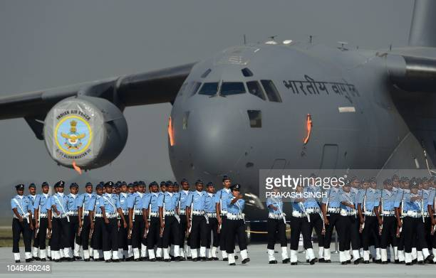 ndian Air Force personnel march during a full dress rehearsal for the Air Force Day parade at the Air Force Station Hindon in Ghaziabad town on the...