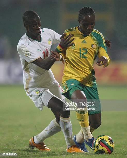 Ndiaye and Modise Teko during the CAF 2008 African Cup of Nations Group D match between Senegal and South Africa at the Baba Yara Stadium in Kumasi...
