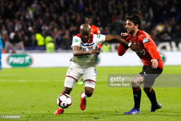 Ndombele Alvaro Tanguy of Lyon and Grenier Clement of Rennes during the French Cup match between Lyon and Rennes at Groupama Stadium on April 2 2019...