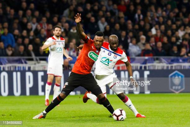 Ndombele Alvaro Tanguy of Lyon and Sitoe Edson of Rennes during the French Cup match between Lyon and Rennes at Groupama Stadium on April 2 2019 in...