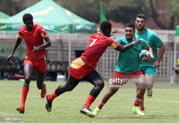 Ndong Stephane Thiour of Senegal challenges El Kadiri Naapap of Morocco during the 2019 Rugby Africa Mens 7s match between Senegal and Morocco at the...