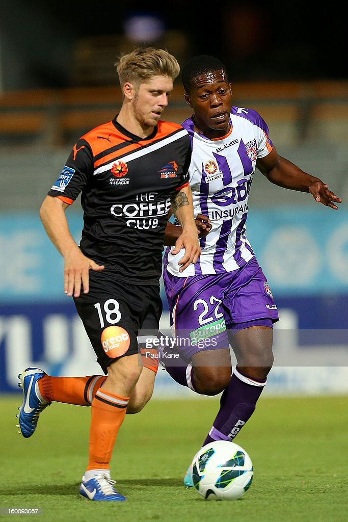 Ndumba Makeche of the Glory looks to challenge Luke Brattan of the Roar during the round 18 A-League match between the Perth Glory and the Brisbane Roar at nib Stadium on January 26, 2013 in Perth, Australia.
