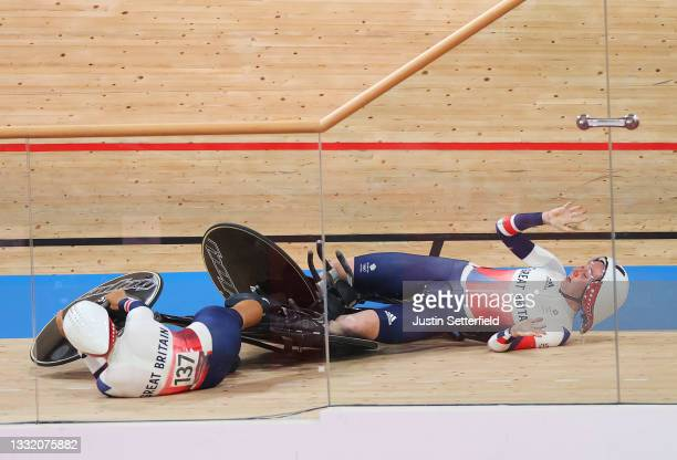 Neah Evans and Katie Archibald of Team Great Britain fall during the celebration after to setting a new Olympic record during the Women's team...
