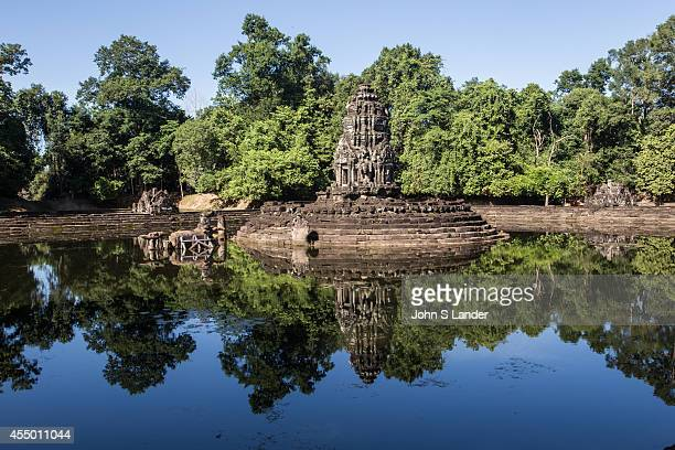 Neak Pean is built on an artificial island with a Buddhist temple on it The temple and pond represent Anavatapta a mythical lake in the Himalayas...