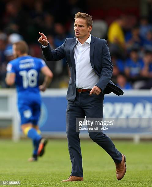 Neal Ardley manager of AFC Wimbledon during the Sky Bet League One match between AFC Wimbledon and Shrewsbury Town at The Cherry Red Records Stadium...