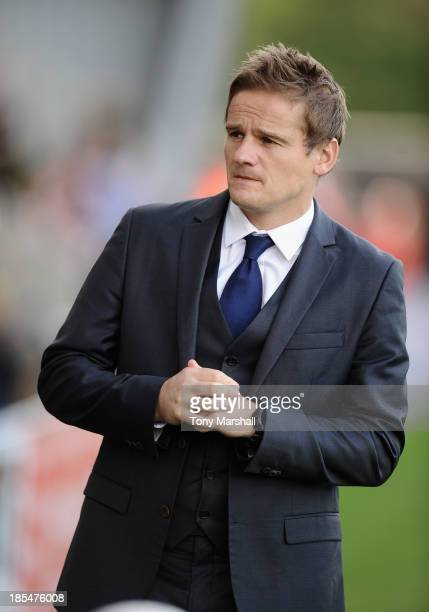 Neal Ardley manager of AFC Wimbledon during the Sky Bet League Two match between Morecambe and AFC Wimbledon at Globe Arena on October 19 2013 in...