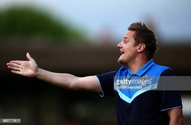 Neal Ardley manager of AFC Wimbledon gestures during the preseason friendly between AFC Wimbledon and Crystal Palace at The Cherry Red Records...