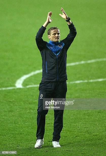 Neal Ardley manager of AFC Wimbledon shows appreciation to the fans after the final whistle during the Sky Bet League One match between Milton Keynes...