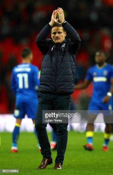 Neal Ardley Manager of AFC Wimbledon shows appreciation to the fans following The Emirates FA Cup Third Round match between Tottenham Hotspur and AFC...