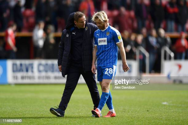 Neal Ardley, Manager of Notts County speaks with Craig Mackail-Smith of Notts County as their team are relegated following the result in the Sky Bet...