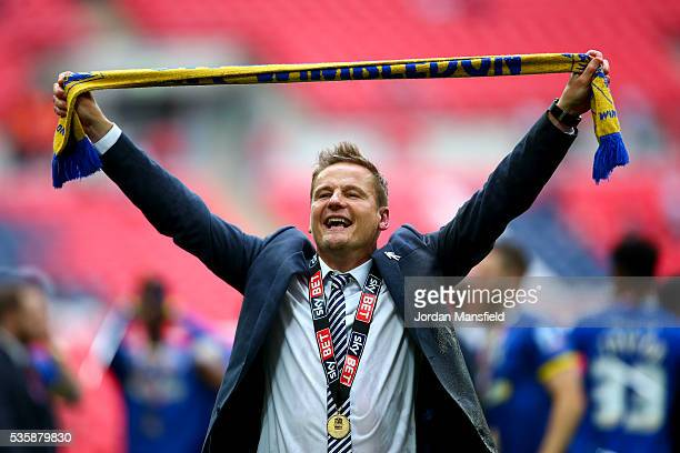 Neal Ardley, manager of Wimbledon celebrates after their victory in the Sky Bet League Two Play Off Final match between Plymouth Argyle and AFC...