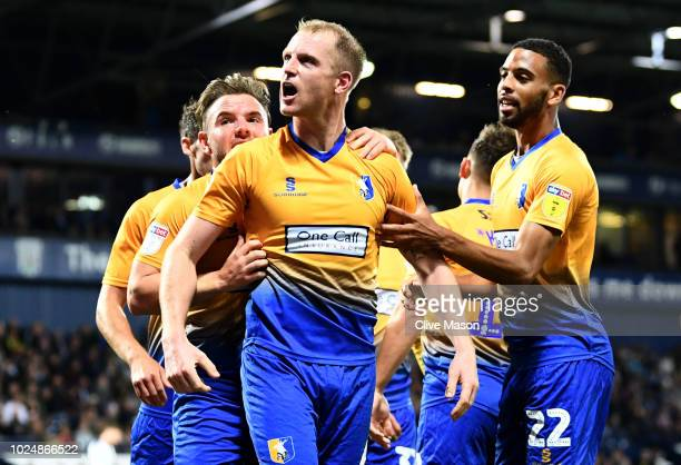 Neal Bishop of Mansfield Town celebrates with teammates after scoring his team's first goal during the Carabao Cup Second Round match between West...