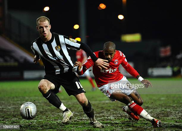 Neal Bishop of Notts County battles with Therry Racon of Charlton Athletic during the npower League One match between Notts County and Charlton...