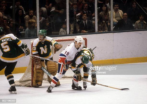 Neal Broten of the Minnesota North Stars is checked by Bryan Trottier of the New York Islanders during the 1981 Stanley Cup Finals in May 1981 at the...