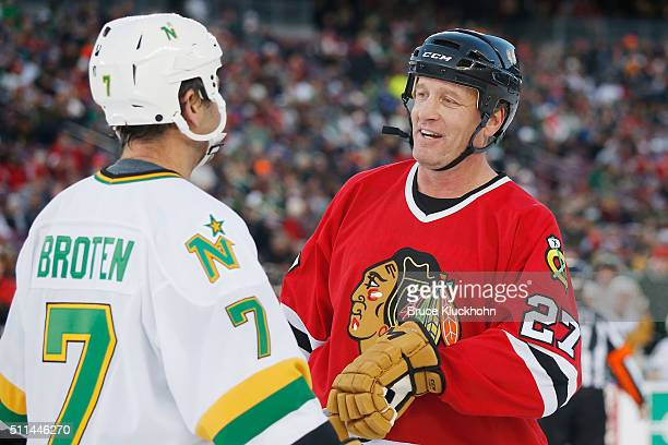 Neal Broten of the Minnesota North Stars/Wild and Jeremy Roenick of the Chicago Blackhawks talk during the Coors Light NHL Stadium Series Alumni game...