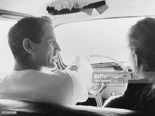 Neal Cassady the inspiration for Dean Moriarty in Jack Kerouac's novel On the Road cruises the streets with a female friend