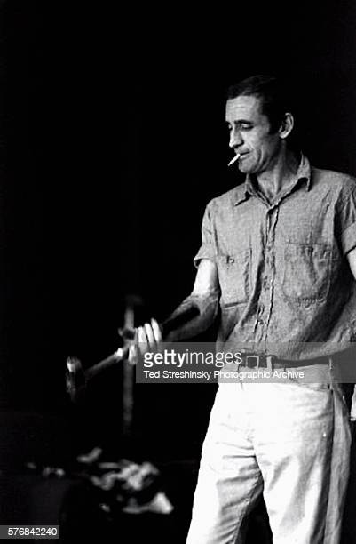 Neal Cassady tosses his hammer around and smokes a cigarette He carried the hammer with him while he traveled with Ken Kesey's Merry Pranksters...