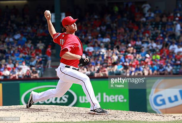 Neal Cotts of the Texas Rangers pitches in the seventh inning against the Kansas City Royals at Rangers Ballpark in Arlington on June 1 2013 in...