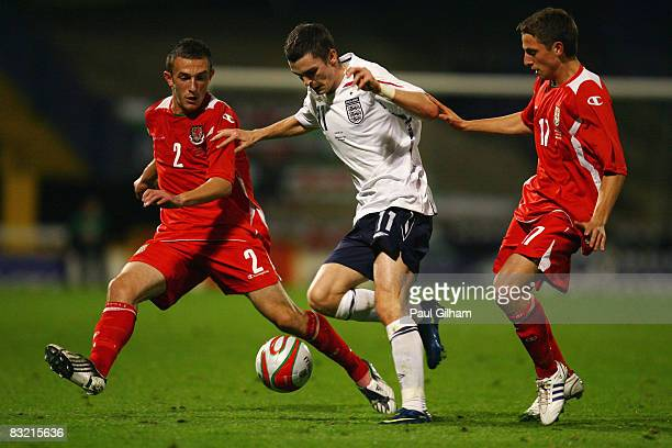 Neal Eardley and Joe Allen of Wales battle for the ball with Adam Johnson of England during the UEFA U21 Championship playoff match between Wales U21...