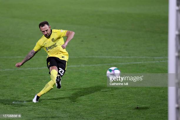 Neal Eardley of Burton Albion scores the winning goal from the penalty spot during the Carabao Cup First Round match between Burton Albion and...