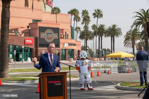 """Neal Kelley, Registrar of Voters for Orange County, speaks as he showcases voting with Anaheim Ducks mascot Wild Wing at the Super Vote Center Site""""..."""