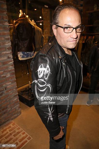 Neal Krone shows off his jacket signed by Kevin Mazur while attending A Tribute To Rock Roll hosted by Schott NYC Featuring Photographs from...