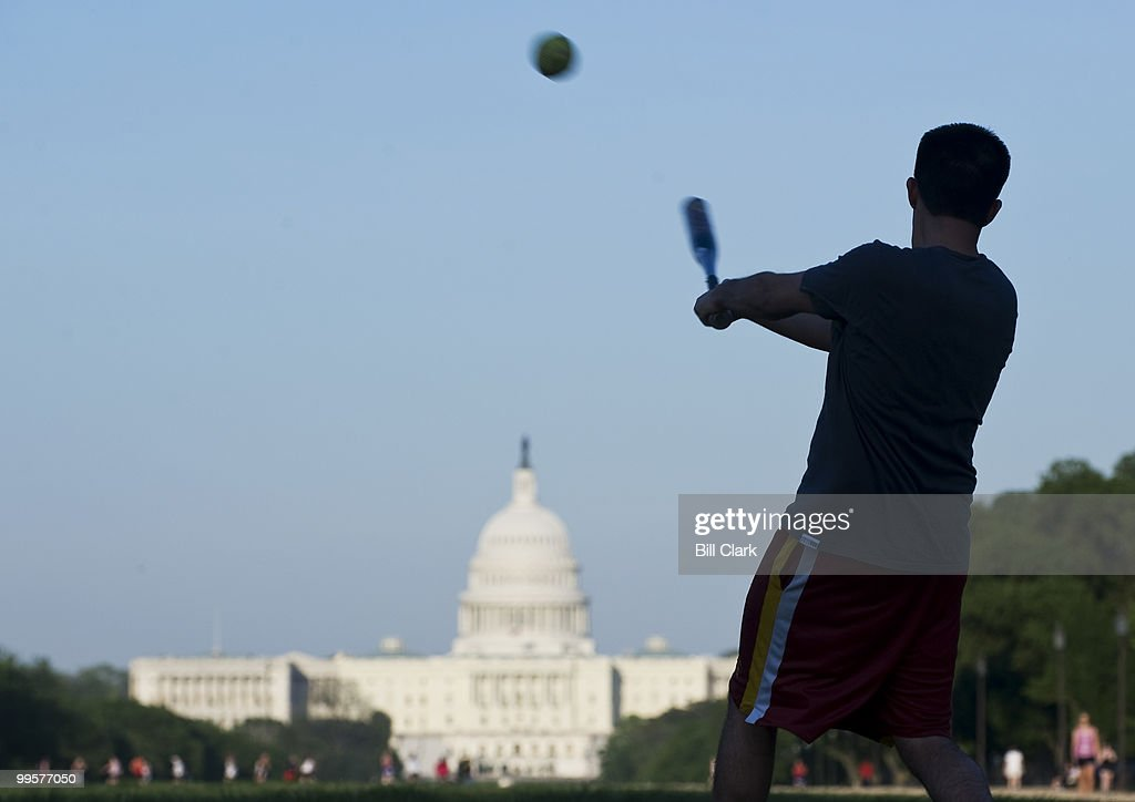 Neal Lunar, of Rep. Ike Skelton's office, hits a ball during the Show Me Asses softball team practice on the National Mall on Monday, April 27, 2009.