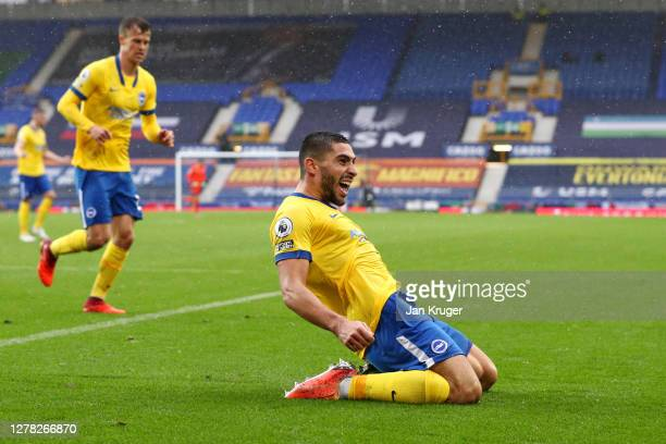 Neal Maupay celebrates after scoring his sides first goal during the Premier League match between Everton and Brighton & Hove Albion at Goodison Park...