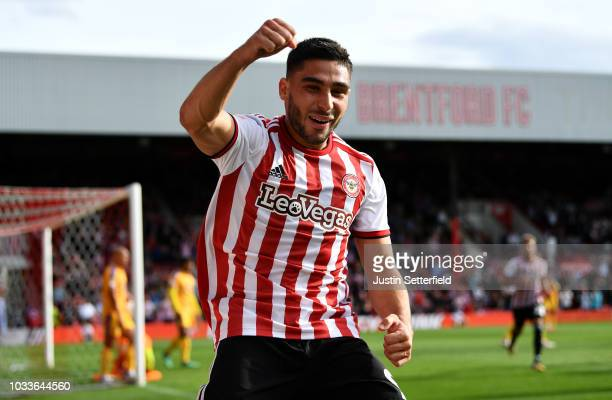 Neal Maupay of Brentford celebrates scoring the 2nd brentford goal during the Sky Bet Championship match between Brentford and Wigan on September 15...