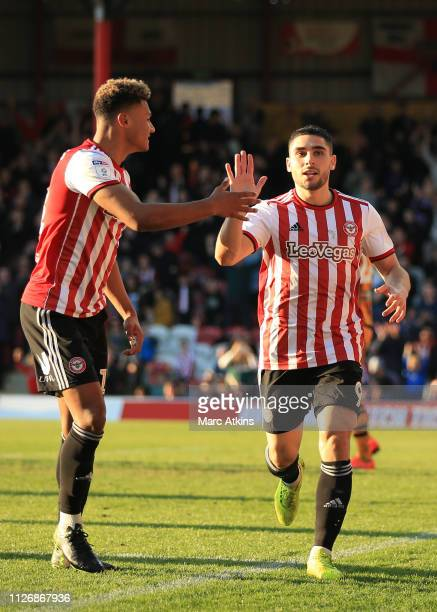 Neal Maupay of Brentford celebrates scoring their 4th goal with Ollie Watkins during the Sky Bet Championship match between Brentford and Hull City...