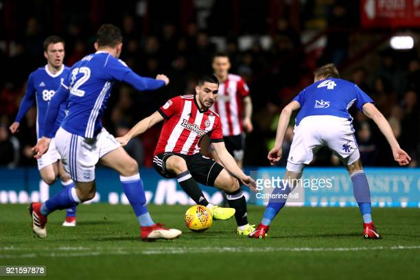 Neal Maupay of Brentford Harlee Dean of Birmingham and Marc Roberts of Birmingham during the Sky Bet Championship match between Brentford and...