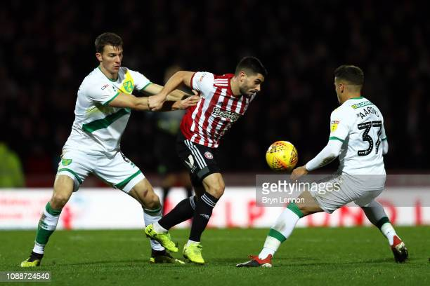 Neal Maupay of Brentford is held back by Christoph Zimmermann of Norwich City during the Sky Bet Championship match between Brentford and Norwich...