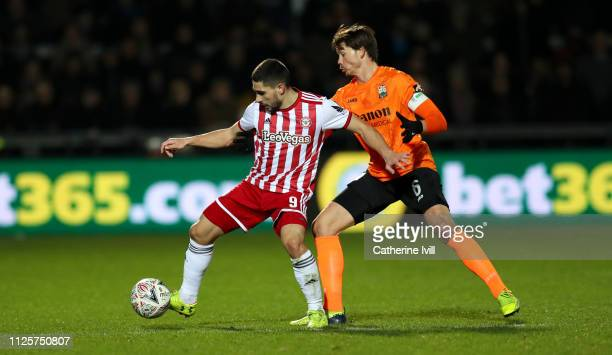 Neal Maupay of Brentford is tackled by Craig Robson of Barnet during the FA Cup Fourth Round match between Barnet and Brentford at The Hive on...