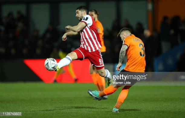 Neal Maupay of Brentford is tackled by Elliot Johnson of Barnet during the FA Cup Fourth Round match between Barnet and Brentford at The Hive on...
