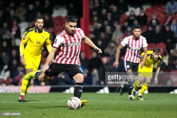 Neal Maupay of Brentford scores from the penalty spot leading to his team's first goal during the FA Cup Third Round match between Brentford and...