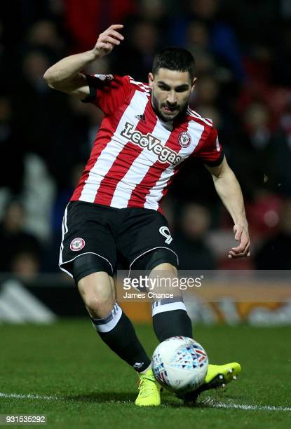 Neal Maupay of Brentford scores his sides first goal during the Sky Bet Championship match between Brentford and Cardiff City at Griffin Park on...