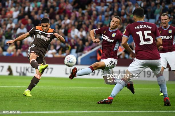 Neal Maupay of Brentford scores his team's first goal during the Sky Bet Championship match between Aston Villa and Brentford at Villa Park on August...