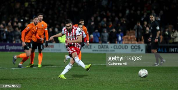 Neal Maupay of Brentford scores his team's second goal from the spot during the FA Cup Fourth Round match between Barnet and Brentford at The Hive on...