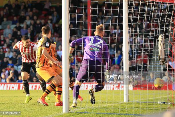 Neal Maupay of Brentford scores their 4th goal during the Sky Bet Championship match between Brentford and Hull City at Griffin Park on February 23...