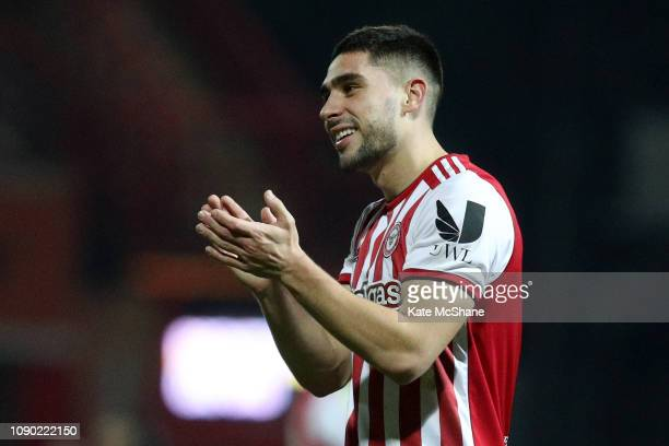 Neal Maupay of Brentford shows appreciation to fans following victory in the FA Cup Third Round match between Brentford and Oxford United at Griffin...