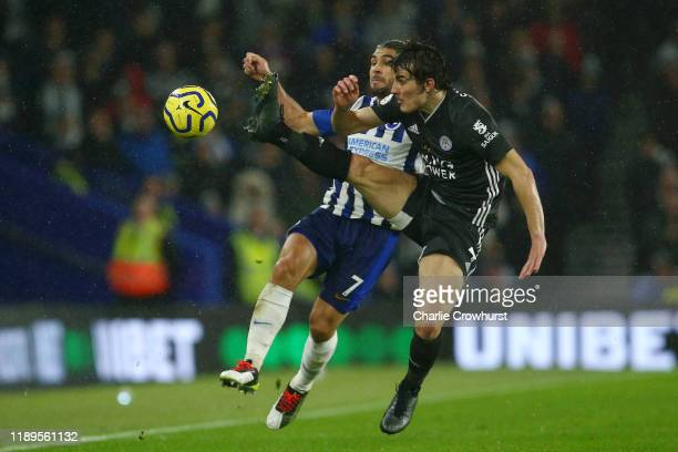 Neal Maupay of Brighton and Hove Albion battles for possession with Caglar Soyuncu of Leicester City during the Premier League match between Brighton...
